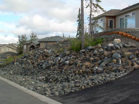 residential-boulder-slope-for-erosion-control-after-b