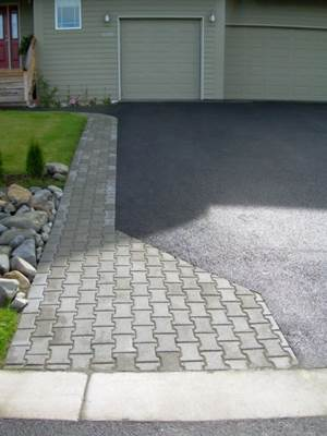 residential-rock-culvert-with-i-brick-paver-driveway-border-a