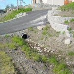Alaska Residential Landscaping Residential Boulder Slope for Erosion Control - Before A
