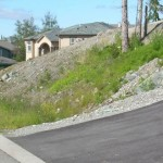 Alaska Residential Landscaping Residential Boulder Slope for Erosion Control - Before B