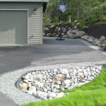 Alaska Residential Landscaping Residential Gravel Driveway Border Rock Culvert and Perennial Garden Boulder Retaining Wall System
