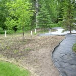 Alaska Residential Landscaping Residential Mulch Island Around Natural Vegetation and Rock Border - Before A