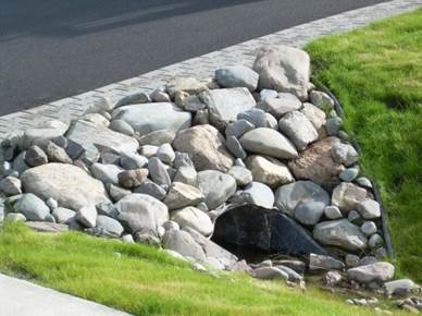 Residential Rock Culvert With I Brick Paver Driveway