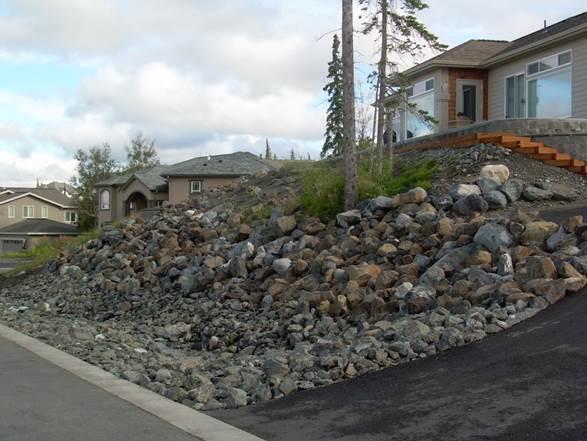 residential-boulder-slope-for-erosion-control-after-b