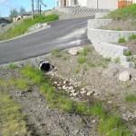 Alaska Residential Landscaping Residential Boulder Slope for Erosion Control - Before A