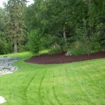 Alaska Residential Landscaping Residential Mulch Island Around Natural Vegetation and Rock Border - After