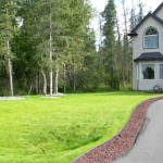 Alaska Residential Landscaping Residential New Construction Landscaping - Lawn Installation and Lava Rock Driveway Border - After A