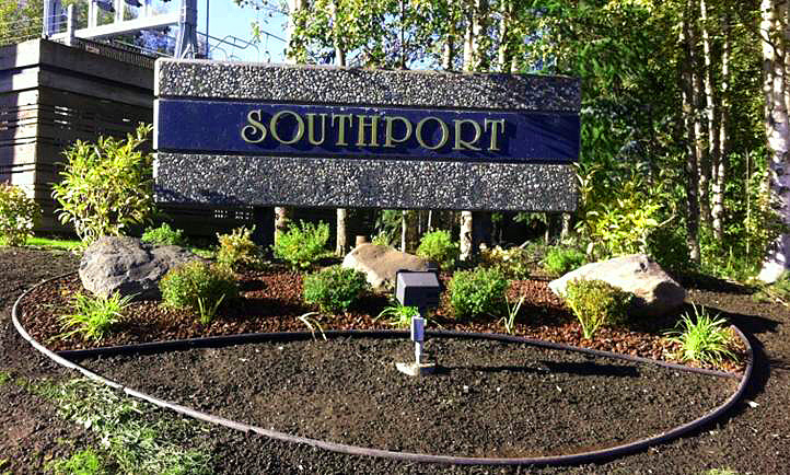 Alaska Commercial Landscaping Southport Master Association Subdivision Monument– Contour the surrounding land to showcase the monument, planting beautiful shrubs and perennials to welcome people to this beautiful subdivision, along with leaving an area for planting flowers in the Spring.