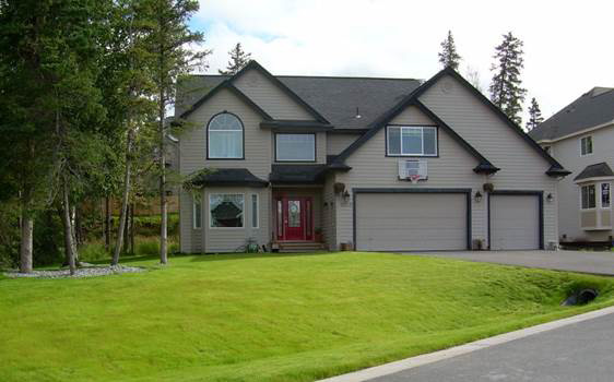 Residential-New-Construction-Landscaping-Lawn-Installation-and-Lava-Rock-Driveway-Border-After-B